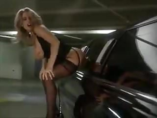 blonde fucks with a dildo on a limousine