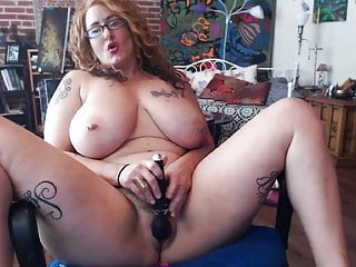 Milf Redhead Webcam video: tattooed alt busty milf playing with herself and squirting