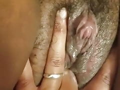 Fingering her creamy pussy