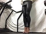 Shiny pvc leggings walking .