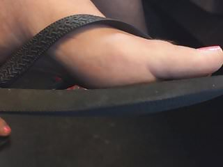 Ultra Close-Up of Women's Feet in Flip Flops