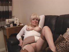 Busty attractive blonde English Milf stripping