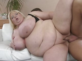 SUPERSIZED mature mother on young boy