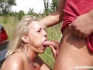 Matures Milfs porno: Hot blonde granny seduces and fucks a young stud outdoors