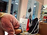 Candid voyeur in shoe store babe trying on shoes