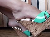 Long slender toes in green wedge shoe
