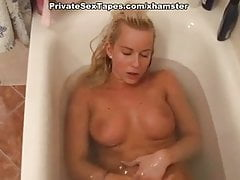 Busty blonde girlfriend masturbates and fucks in bathroom