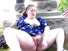 a fat mature masturbates in an American cemetery