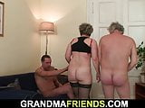 Old granny in stockings takes it from both sides