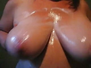 bouncing oiled boob dance