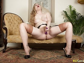 Satine Spark fucks her hairy pussy in suspenders, nylons and heels