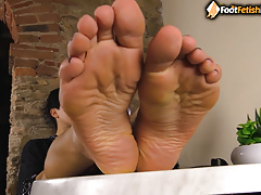 Sexy brunette takes stockings off puts feet in your face