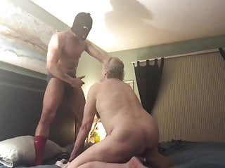 Grandpa is forced to suck mask man's cock