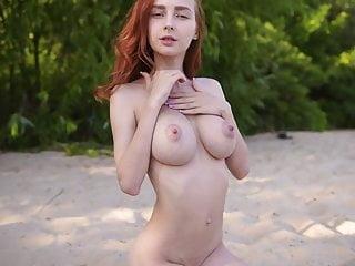Amazing young redhead Helga Gray displays her huge natural