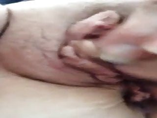 Granny rubs her wet pussy