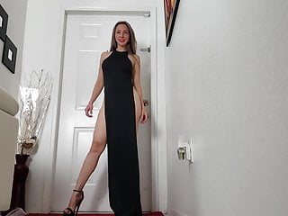 Posing in ebony excessive heels & lengthy gown with excessive slit legs