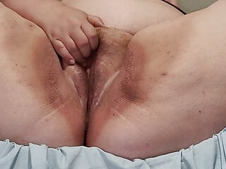 my bbw playing with her clit while watching porn