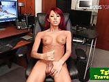 Heeled redhead ladyboy jerking her hard cock