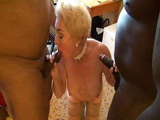 Blonde Gilf holding 2 BBC's
