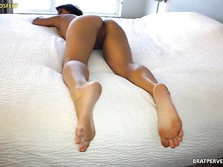 Her bare soles and thick...