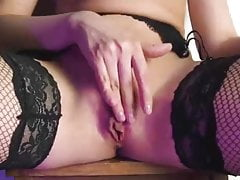 Sexy blonde after striptease fucks herself with a big dildo
