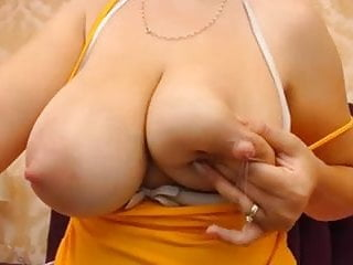 Squirting delicious milk from her perfect giant tits