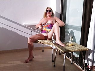a Debbie in hotel pussy with banana a her balcony on
