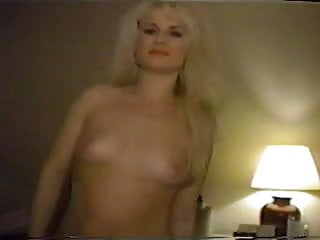 Blonde whore stripping and flaunting...