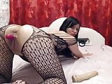 Brunette with red vibrator in the vagina