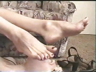 licking large horns with a pedicure. lesbian.
