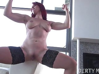 Pussy rubbing ginger muscle slut poses and displays off