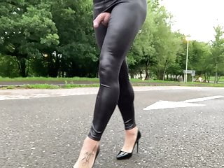 Road walking in PVC black leggings .