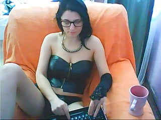Big titted brunette jerking a hard fake cock on webcam