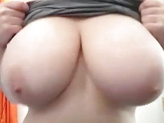 Girls tits plays with her nipples...