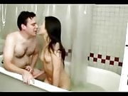 Asian and white fucking in bathtub