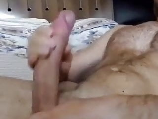 hairy man with a massive cock jacks out a load