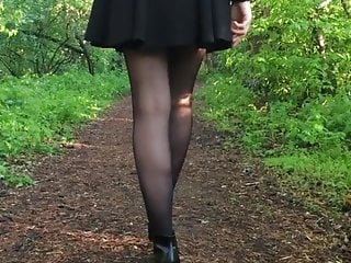Russian TEEN walking in short skirt, high heels and nylons