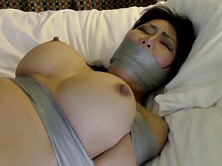 Busty JAV tied plus gagged with tape on bed