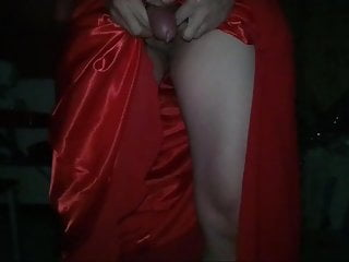 Crossdressing in red satin long gown...