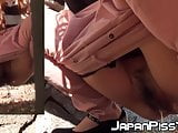 Japanese brunette squats while pissing outdoors