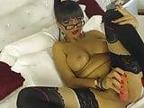 Sexy Latina smokes and dilldos shaven pussy