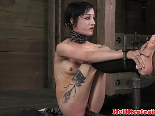 Restrained slave punished with anal hook