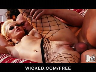 Sultry blonde dominatrix Ash Hollywood is fucked hard by her