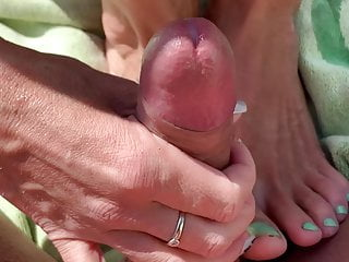 Outdoor blowjob with happy ending at her pretty feet