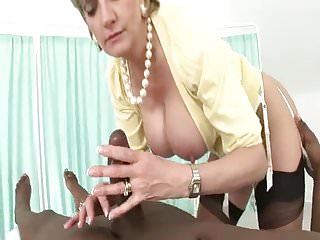 British MILF Blows A Young BBC