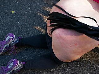 Kneeling middle of the street and whipping her...