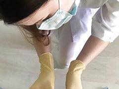 Female doctor examines penis