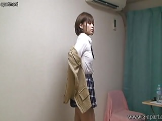 Japanese girl take off school uniform