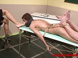 Dominant beauty tormenting her lesbo slave