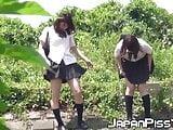Japanese schoolgirl babes have fun peeing outdoors